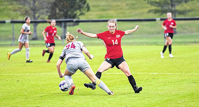 Rio Grande's Ciera Goin tries to kick the ball away from Indiana University East's Kelsea Joseph during Saturday night's game at Evan E. Davis Field. The Red Wolves edged the RedStorm, 1-0.