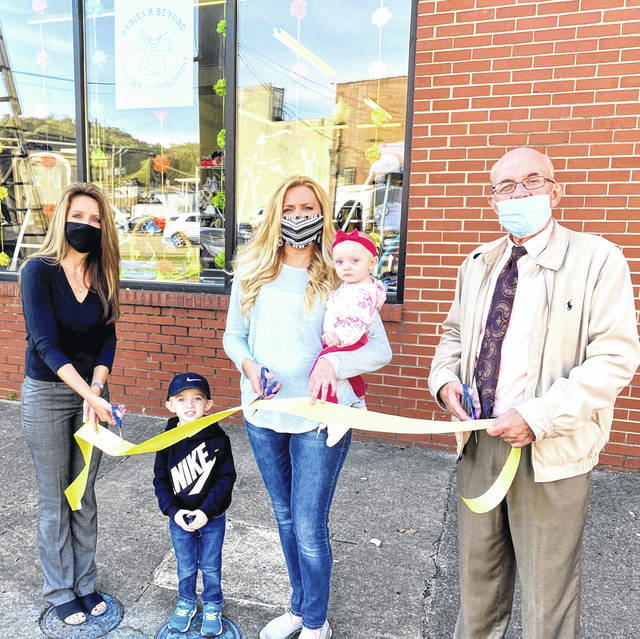 This week, Babies 'N Beyond, a consignment store specializing in children's clothing and baby gear, at 208 Fourth Street in downtown Point Pleasant, celebrated its grand reopening with a ribbon cutting attended by new owner Delyssa Edwards and her children Easton and Dallisyn Edwards, pictured, along with City Clerk Amber Tatterson and Mayor Brian Billings. The store reopens for business this Friday, Oct. 16. Regular store hours are as follows 10 a.m. - 4 p.m., Wednesdays and Thursdays; 10 a.m. - 6 p.m., Fridays; 10 a.m. - 4 p.m., Saturdays. Find Babies 'N Beyond on Facebook for more information. (Shannon Myers   Courtesy)