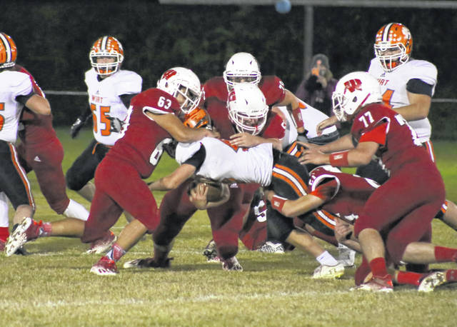 Wahama defenders Angel Garcia (63) and Michael VanMatre bring down a Wirt County ball carrier during the first half of Friday night's LKC football contest at Bachtel Stadium in Mason, W.Va.