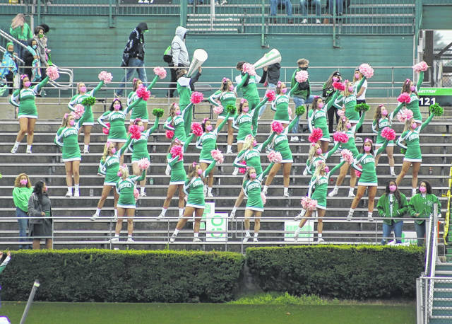 Marshall University hosted its annual homecoming festivities on Saturday with the recognition of homecoming royalty while the Thundering Herd football team took down Florida Atlantic in a 20-9 victory. The 2020 Mr. and Miss Marshall Mel Thomas and Kristen Shomo, respectively, were recognized. Pictured are MU Cheerleaders in the age of COVID-19, cheering on The Herd while practicing social distancing. (Bryan Walters | OVP Sports)