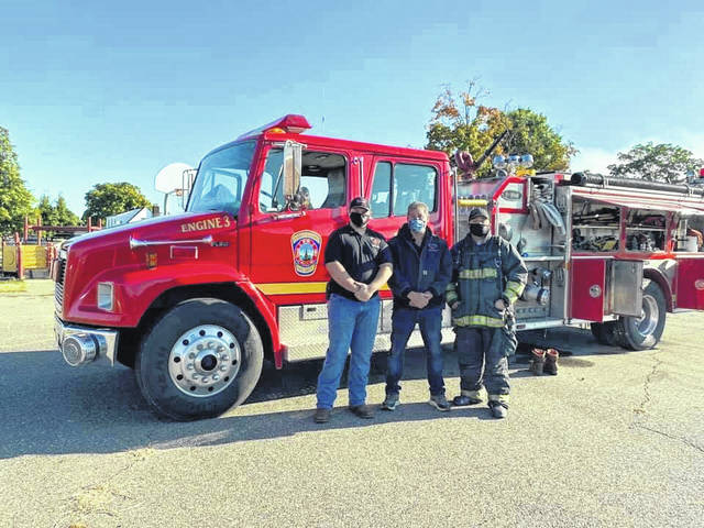 Pictured are Junior Firefighter Trenton Mayes, Firefighters Tim Holley and Jason Harrison with the Point Pleasant Volunteer Fire Department. Firefighters recently visited area elementary schools as part of Fire Prevention Week/Month. (PPVFD | Courtesy)