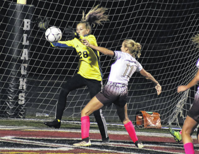PPHS junior goalkeeper Elicia Wood (28) snags one of her 14 saves in front of Williamstown junior Ella McMullen (11), during the scoreless tie on Tuesday in Point Pleasant, W.Va.