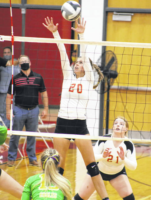 South Gallia junior Cara Frazee (20) goes up for a block in front of teammate Emma Shamblin (21), during the Lady Rebels' match against Eastern on Sept. 17 in Mercerville, Ohio.