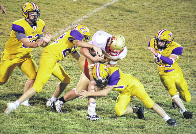 Tornadoes Brayden Otto (11) and Griffen Miller (22) bring down South Gallia's Ean Combs, during Southern's Week 5 victory at Roger Lee Adams Memorial Field in Racine, Ohio.