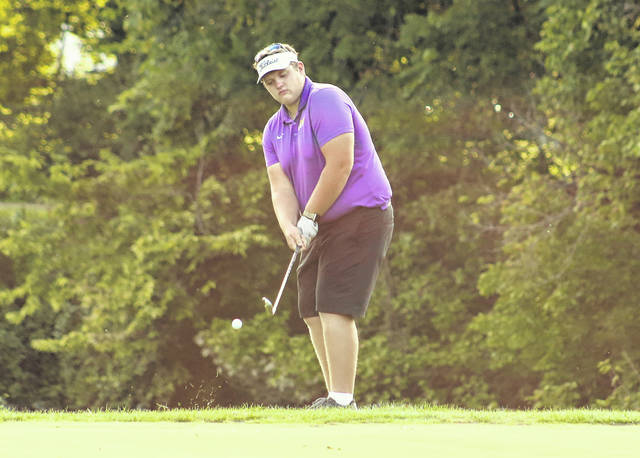 Southern senior David Shaver hits a chip shot onto the ninth green during a Sept. 22 golf match at Riverside Golf Course in Mason, W.Va.