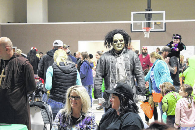 "Though the Point Pleasant Halloween Block Party has been canceled, trick-or-treat times across Mason County have been set. Pictured from last year's block party, Wayne, Garth and Billy Butcherson from ""Hocus Pocus."" (OVP File Photo)"