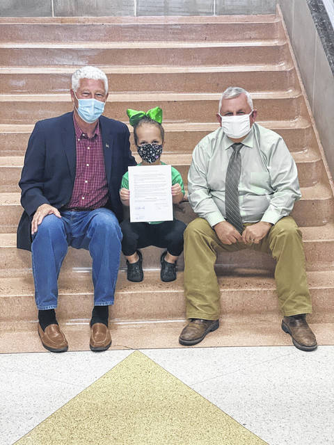 At their recent meeting, Mason County Commissioners declared October as Dwarfism Awareness Month in Mason County. Pictured from left are Commission President Rick Handley, Hadleigh Cossin and Commissioner Sam Nibert.