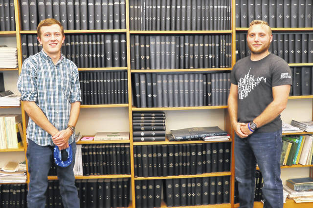 Glenville State College students Asa Dick (left) and Jacob Petry (right) have both successfully passed the Fundamentals of Surveying exam on their first take.
