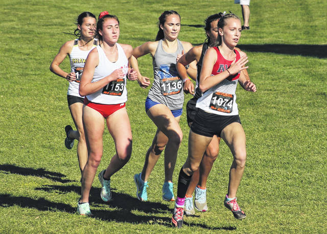 Gallia Academy senior Sarah Watts (1136) keeps pace with a pack of runners during Saturday's Division II girls cross country championships held at Fortress Obetz in Obetz, Ohio.