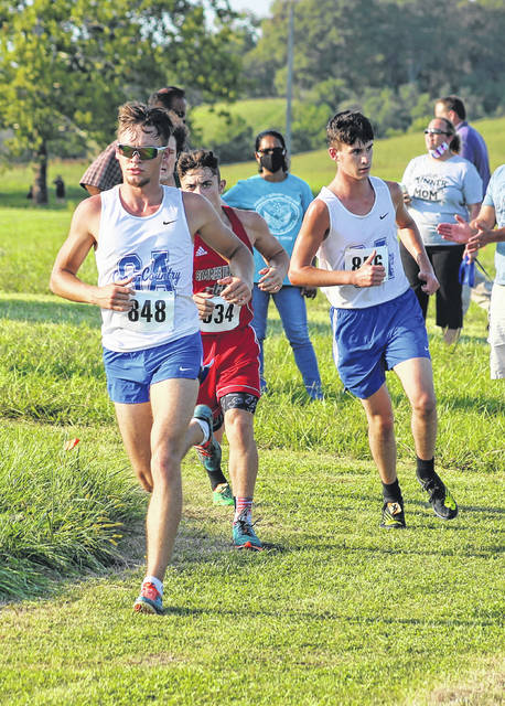 Gallia Academy senior Tristin Crisenbery (848) leads a pack of runners around a turn at the 2020 Skyline Bowling Cross Country Invitational held on Sept. 8 at Gallia Academy High School in Centenary, Ohio.