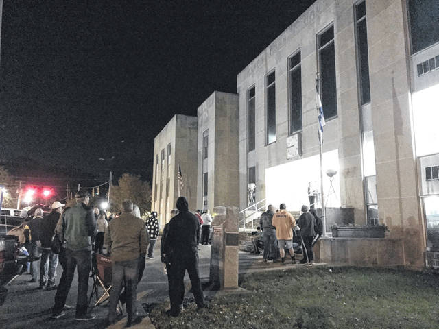 A crowd gathers outside the Mason County Courthouse, listening to an election update from Mason County Clerk Diana Cromley on Tuesday night. (Beth Sergent | OVP)