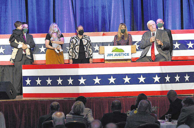 West Virginia Gov. Jim Justice, First Lady Cathy Justice and members of their family greet supporters during Justice's victory celebration Tuesday night at the Greenbrier. Justice won re-election in Tuesday's General Election. (Photo courtesy of The Register-Herald | Rick Barbero)