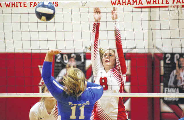 Wahama junior Hailey Darst (8) blocks a Glimer County spike attempt, during the Lady Falcons' 3-1 setback on Tuesday in Mason, W.Va.
