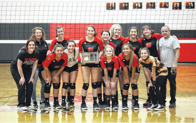 Members of the Point Pleasant volleyball team pose for a picture with the championship trophy, following the Class AA Region IV, Section 1 final on Thursday in Point Pleasant, W.Va.