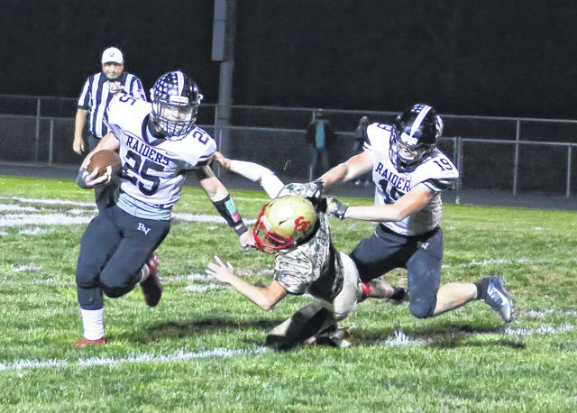 River Valley running back Michael Conkle (25) delivers a stiff arm to a South Gallia defender during an Oct. 9 football contest in Mercerville, Ohio.