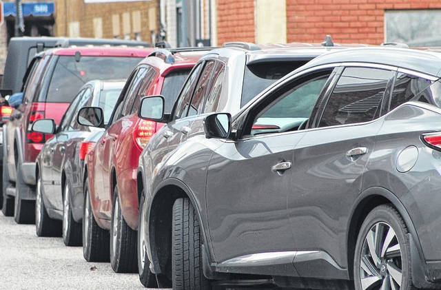 Cars wait in line for a free drive-thru COVID-19 test at one of many free testing sites which have been set up in Mason County. (Beth Sergent | OVP)