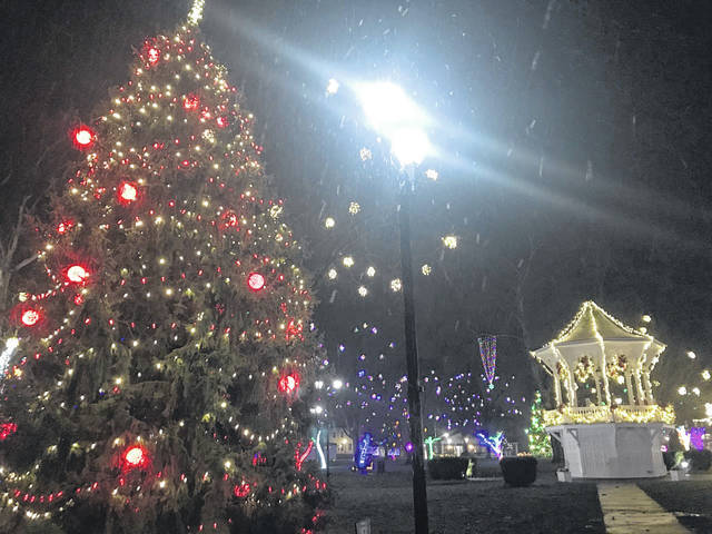 Snow began falling in Gallipolis City Park on Monday evening, accenting the annual Gallipolis In Lights display which is currently open to the public. Many displays are closer to the road so visitors can drive around the park without exiting their vehicles. The park is open for those who wish to walk through but those who choose to enter on foot are asked to wear a face covering and practice social distancing. More photos from this year's display in an upcoming edition. (Beth Sergent | OVP)
