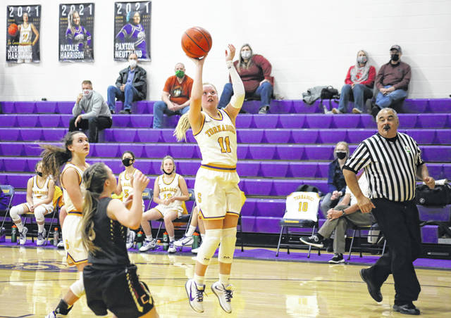 Southern junior Kelly Shaver (11) shoots a layup, during the second half of the Lady Tornadoes' 63-25 setback on Wednesday in Racine, Ohio.
