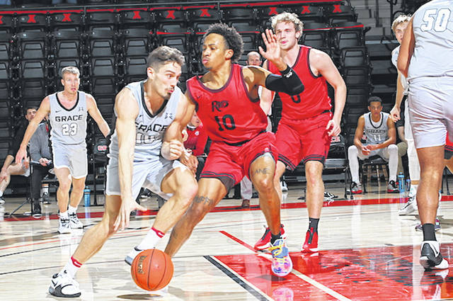 Rio Grande's Kam Harris guards Grace College's Haden Deaton during Wednesday night's 78-64 loss to the Lancers in Winona Park, Ind.