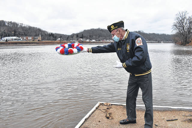 John Hood, a member of the Stewart-Johnson V.F.W. Post 9926 of Mason and Drew-Webster American Legion Post 39 of Middleport, is pictured as he tosses a patriotic wreath into the Ohio River to mark the anniversary of Pearl Harbor. (Mindy Kearns | Courtesy)