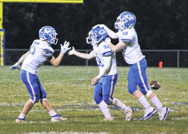 Gallia Academy freshman Cole Hines, middle, is congratulated by teammates after recovering a fourth quarter fumble against Wellston on Sept. 19 at C.H. Jones Field in Wellston, Ohio.