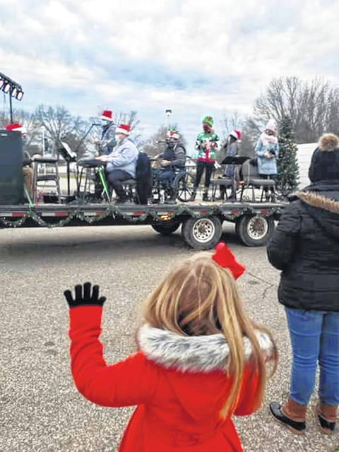 Members of the LifeSpring Community Church praise team travel the streets of Point Pleasant to sing Christmas carols.
