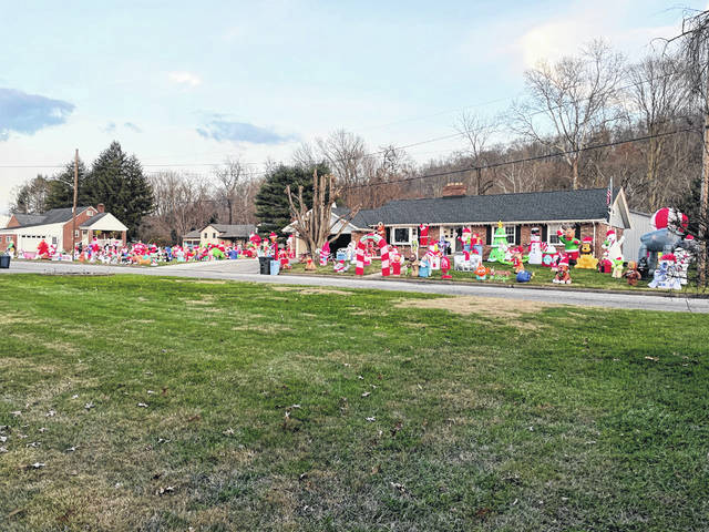 The McKinneys, at 2012 Maxwell Avenue, are collecting donations for the Point Pleasant Fire Department Christmas food basket program. A donation box is at the end of the driveway among 160 Christmas inflatable decorations.
