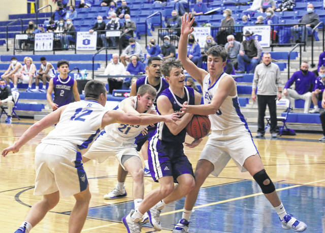 Gallia Academy junior Connor Walter, right, applies defensive pressure to a Chesapeake player during the second half of Friday night's boys basketball contest in Centenary, Ohio.