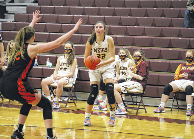 Meigs sophomore Rylee Lisle (22) lines up a three-pointer, during the second half of the Lady Marauders' 60-53 setback on Monday in Rocksprings, Ohio.