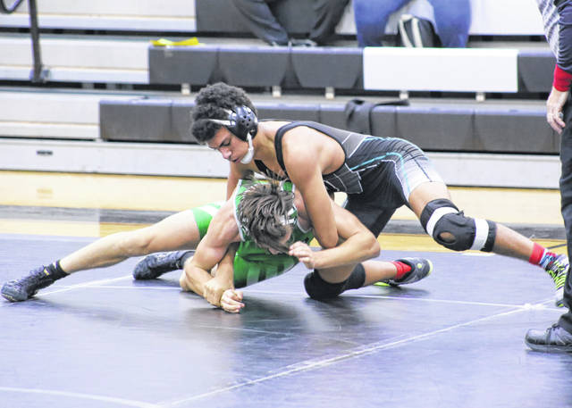 River Valley junior Nathan Brown locks in a hold on a Waterford grappler during a 152-pound match held at River Valley High School on Dec. 30, 2020, in Bidwell, Ohio.