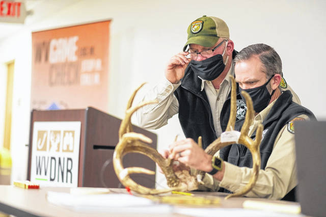 Officials from the West Virginia Division of Natural Resources are pictured on Wednesday at a virtual buck scoring event to determine if a buck harvested in Wyoming County is one of the largest taken in North America in the last five years or among the top 25 of all time. (Office of Gov. Jim Justice | Courtesy)