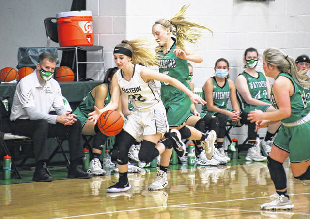 Eastern senior Kennadi Rockhold (22) steals the ball in front of the Waterford bench, during the second half of the Lady Wildcats' 53-36 victory on Wednesday in Tuppers Plains, Ohio.