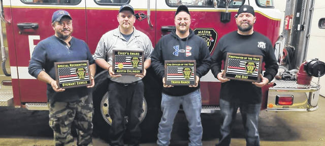 Four members of the Mason Volunteer Fire Department were presented awards recently including, from left, Stewart Zerkle, Special Recognition Award; Austin Ohlinger, Chief's Award; Travis Nance, Fire Officer of the Year; and Joe Day, Firefighter of the Year. (Courtesy photo)