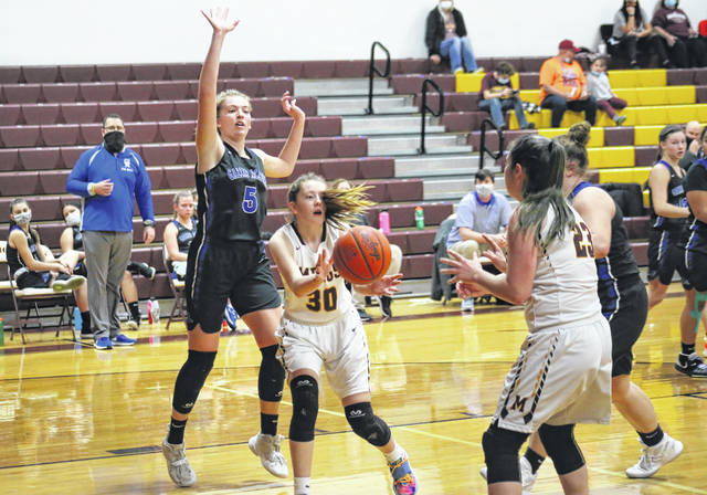 Meigs freshman Andrea Mahr (30) passes to teammate Jerrica Smith (23), in front of GAHS senior Maddy Petro (5), during the Lady Marauders' 13-point victory on Saturday in Rocksprings, Ohio.