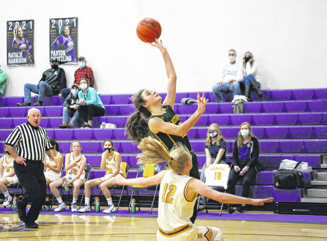Eastern sophomore Erica Durst shoots over Southern junior Kayla Evans, during the Lady Eagles' Dec. 21 victory in Racine, Ohio.