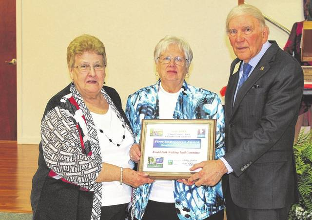 Pictured from a previous year, from left, Darlene Haer and Becky Wood, accepted the award for Best Community Project for the Point Pleasant Walking Trail at Krodel Park, on behalf of the walking trail committee. Presenting was Chamber President Mario Liberatore. The Chamber is currently accepting nominations for this year's awards. (OVP File Photo)
