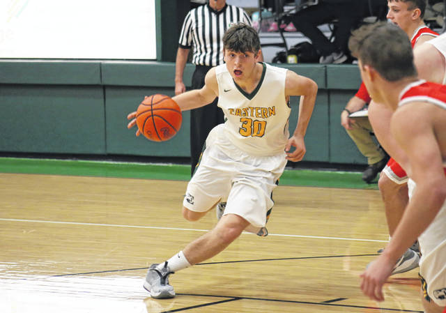 Eastern senior Brad Hawk (30) drives to the paint, during the first half of the Eagles' 57-29 loss to Trimble on Dec. 11 in Tuppers Plains, Ohio.