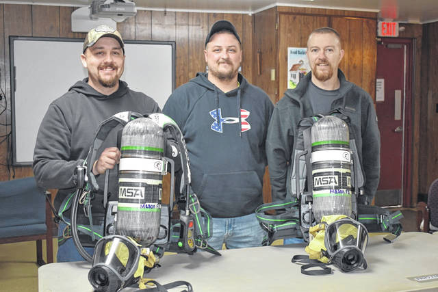 Mason Volunteer Fire Department Second Lieutenant Jeff Zerkle, Deputy Chief Travis Nance, and Chief Howard Wood, from left, are pictured with two of the dozen new self-contained breathing apparatus units they recently received. The majority of the cost for the units, along with 24 extra tanks, was covered by a FEMA Assistance to Firefighters Grant. (Mindy Kearns | Courtesy)