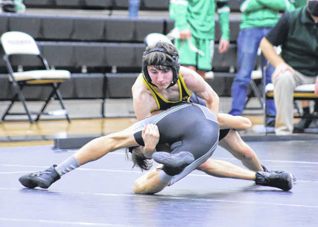 Meigs senior Jarod Koenig locks in a hold on a River Valley grappler during a 106-pound match held on Wednesday, Dec. 30, 2020, at RVHS in Bidwell, Ohio.