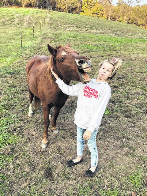 Offering a break from all the bad news in the world, this photo shows Caitlyn Durst, 12, of Point Pleasant, horsing around with her friend Buster, who is 13 years old. (Courtesy)