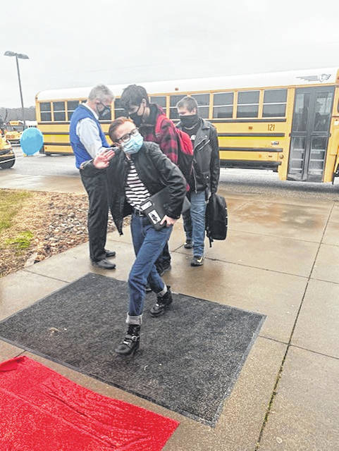 Students were greeted by staff when they arrived at the school.