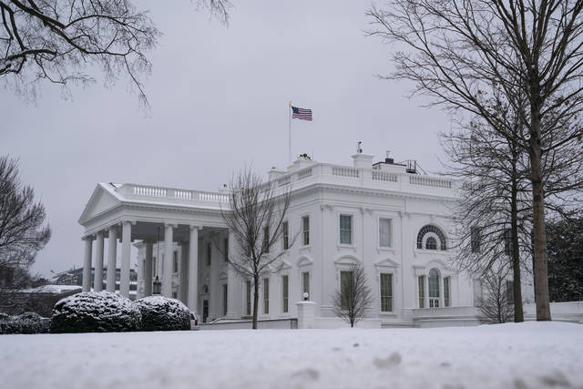 Snow covers the ground at the White House, Monday, Feb. 1, 2021, in Washington. (AP Photo/Evan Vucci)
