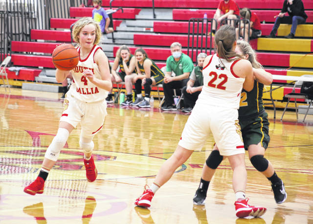 South Gallia freshman Macie Sanders (4) dribbles past an Eastern defender while using a screen set by teammate MaKayla Waugh during the second half of Thursday night's girls basketball contest in Mercerville, Ohio.