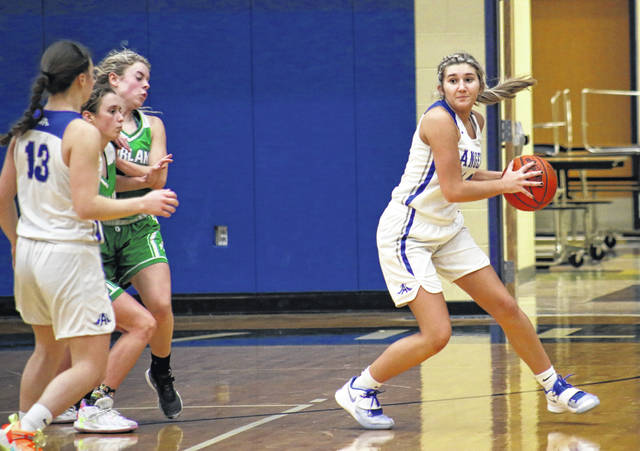 GAHS freshman Emma Hammons (right) steals the ball and passes to junior teammate Preslee Reed (13), during the first half of the Blue Angels' 60-29 setback on Monday in Centenary, Ohio.