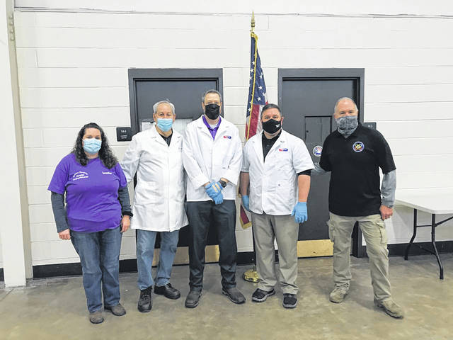 The weather didn't stop a planned COVID-19 vaccination clinic at the National Guard Armory in Mason County on Thursday. Pictured from left are Jennifer Thomas of the Mason County Health Department, Dr. Dan Trent from PVH, Andy Becker and Drew Massey from Fruth Pharmacy and Dennis Zimmerman from Mason County OES. (PVH | Courtesy)