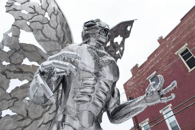 "Ice, snow and freezing temperatures made travel treacherous and caused power outages for some across the area on Tuesday. Meigs, Mason and Gallia counties are also expected to be under a new ""winter storm watch"" beginning today. Pictured is the Mothman statue on Tuesday evening, with ice covering his claws, wings and other parts of his body. (Beth Sergent 
