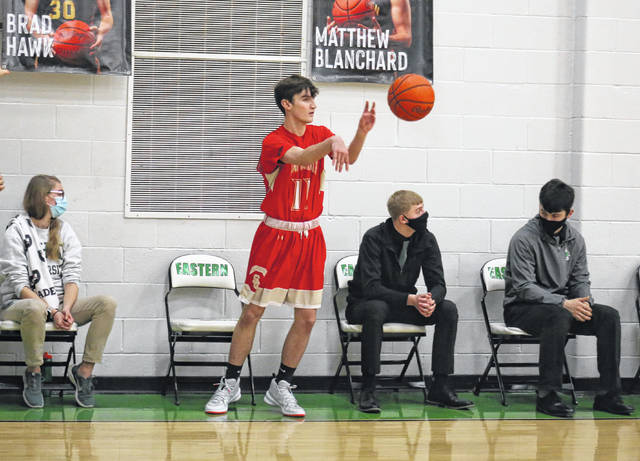 South Gallia's Ethan Bevan throws an inbound pass, during the fourth quarter of the Rebels' 61-32 victory on Friday in Tuppers Plains, Ohio.