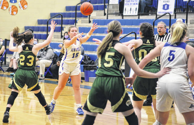 GAHS senior Koren Truance passes to classmate Maddy Petro (5), during the Blue Angels' 10-point win on Friday in Centenary, Ohio.