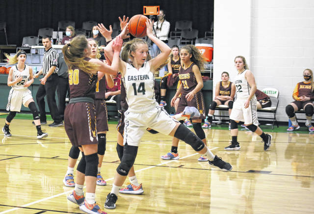 Eastern sophomore Sydney Reynolds (14) grabs an offensive rebound before making the go-ahead basket just before halftime, during the Lady Eagles' 57-48 victory on Wednesday in Tuppers Plains, Ohio.