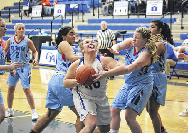 Gallia Academy sophomore Chanee Cremeens puts an offensive rebound back up, during the second half of the Blue Angels' 56-26 victory on Friday in Centenary, Ohio.